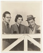 view Photograph of Enrique Riverón, unidentified woman, and Jimmy Saro digital asset number 1