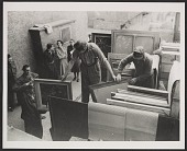 view Edith Standen, Rose Valland and a soldier converse while men prepare paintings for transportation digital asset number 1