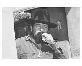 view Nicholas Herrera smoking a cigar digital asset number 1