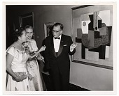 view Aline and Eero Saarinen in formal dress with a Picasso painting digital asset number 1