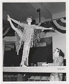 view Woman in costume on stage at the Museum of Merchandise digital asset number 1
