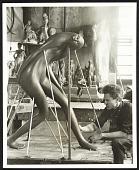 view Hugo Robus working on a sculpture digital asset number 1