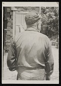 view Source material for <em>Tribute to the American Working People</em>. Back view of man with a cap digital asset number 1