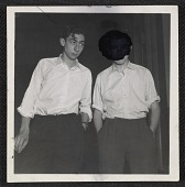 view Two teenage boys with their hands in their pockets digital asset number 1