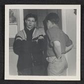 view Two teenage boys standing in front of a door digital asset number 1