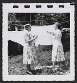 view Women hanging laundry digital asset number 1