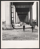 view Photograph of Robert Smithson walking under a bridge in Pine Barrens, New Jersey digital asset number 1
