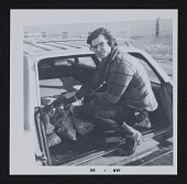 view Photograph of Robert Smithson in car trunk with stones digital asset number 1