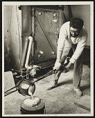 view Paul Suttman pouring bronze at the University of Michigan digital asset number 1