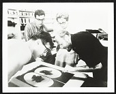 view Emiliano Sorini, Irwin Hollander, June Wayne and Emerson Woelffer inspecting one of Woelffer's lithographs digital asset number 1