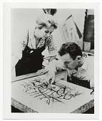 view Romas Viesulas examining a lithographic stone with June Wayne digital asset number 1