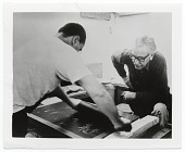 view Adja Yunkers watching as Bohuslav Horak inks a lithographic stone digital asset number 1