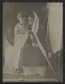 view Jessie Olssen Tanner and Jesse Ossawa Tanner posing for Henry Ossawa Tanner's painting <em>Christ and his mother studying the scriptures </em> digital asset number 1