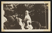 view Photograph of Mary Tarbell Shaeffer and Emeline A. Tarbell with Edmund C. Tarbell II on horse, Peanut digital asset number 1