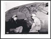 view Sergeant Wayne Thiebaud painting on a B-29 aircraft at Mather Field, Calif. digital asset number 1