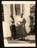 view Bob Thompson (14 years old) and his mother Bessie on their side lawn after his sister Phyllis' wedding digital asset number 1