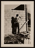 view Series of photographs showing the building of a ceramic shop digital asset number 1