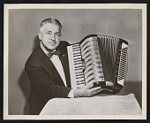 view Photograph of John Vassos holding the Marchesa model accordion he designed for M. Hohner digital asset number 1