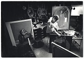 view Photograph of Carol Wald with a cat in her studio digital asset number 1