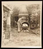 view Carl Walters feeding fire of wood kiln digital asset number 1