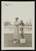 view Katharine Ward Lane Weems standing next to a dog on a pedestal digital asset number 1