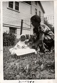 view Lee Harris sitting on lawn with his grandmother, Nana digital asset: Lee Harris sitting on lawn with his grandmother, Nana