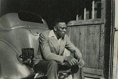 view Young Howard Brown sitting on a car in Hackensack, New Jersey digital asset: Young Howard Brown sitting on a car in Hackensack, New Jersey