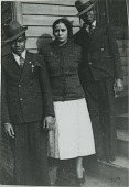 view James Tinsley, young Henrietta Brown, and Neil Harris standing in front of a house digital asset: James Tinsley, young Henrietta Brown, and Neil Harris standing in front of a house