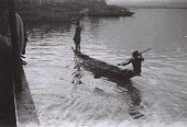 view Field Work in the Eastern Region (Nigeria): Niger River, Asaba-Onitsha Ferry Crossing: Dug-out Canoe near Ferry Landing digital asset: Field Work in the Eastern Region (Nigeria): Niger River, Asaba-Onitsha Ferry Crossing: Dug-out Canoe near Ferry Landing