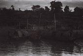 view Field Work in the Eastern Region (Nigeria): Niger River, Asaba-Onitsha Ferry Crossing: Houseboats near Ferry Landing digital asset: Field Work in the Eastern Region (Nigeria): Niger River, Asaba-Onitsha Ferry Crossing: Houseboats near Ferry Landing