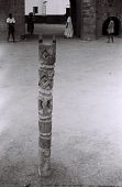 view Field Work in Ilorin, Northern Region (Nigeria): One of Four Sculpted Wood Poles in front of Entrance to Emir's Palace digital asset: Field Work in Ilorin, Northern Region (Nigeria): One of Four Sculpted Wood Poles in front of Entrance to Emir's Palace