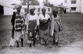 view Field Work in Ibadan, Western Region (Nigeria): Four Women (probably Yoruba Informants) Wearing Elaborate Headdresses digital asset: Field Work in Ibadan, Western Region (Nigeria): Four Women (probably Yoruba Informants) Wearing Elaborate Headdresses