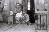 view Field Work in Creek Town, Eastern Region (Nigeria): Wire Recording Session of Unidentified Woman (probably Efik Informant) digital asset: Field Work in Creek Town, Eastern Region (Nigeria): Wire Recording Session of Unidentified Woman (probably Efik Informant)