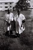 view Field Work in Ibadan, Western Region (Nigeria): Two Men (probably Yoruba Informants) Wearing Traditional Yoruba Clothes and Hats digital asset: Field Work in Ibadan, Western Region (Nigeria): Two Men (probably Yoruba Informants) Wearing Traditional Yoruba Clothes and Hats