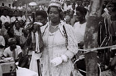 view Field Work in Big Qua Town, Calabar, Eastern Region (Nigeria): Wire Recording Session of a Wedding Ceremony Attended by Ntoe Ika Ika Oqua II, Paramount Ruler of the Qua Clan: the Bride Surrounded by Women Chanting, Handclapping and Drumming digital asset: Field Work in Big Qua Town, Calabar, Eastern Region (Nigeria): Wire Recording Session of a Wedding Ceremony Attended by Ntoe Ika Ika Oqua II, Paramount Ruler of the Qua Clan: the Bride Surrounded by Women Chanting, Handclapping and Drumming