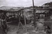 view Field Work in Ibadan, Western Region (Nigeria): Large Indigo Dye Pots Used to Create Adire Clothes digital asset: Field Work in Ibadan, Western Region (Nigeria): Large Indigo Dye Pots Used to Create Adire Clothes