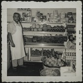 view Almore Dale standing by fruit display digital asset: Almore Dale standing by fruit display