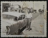 view Almore Dale standing by his Buick digital asset: Almore Dale standing by his Buick