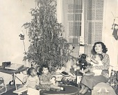 view Mother and children pose by Christmas tree digital asset: Mother and children pose by Christmas tree