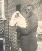 view Percival Bryan holding a baby digital asset: Percival Bryan holding a baby