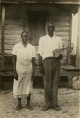 view Parris and Rosa Capers [Gullah informants] in front of their house on St. Helena Island, S.C digital asset: Parris and Rosa Capers [Gullah informants] in front of their house on St. Helena Island, S.C
