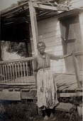 view Diana Brown [Gullah informant] standing in front of her house on Edisto Island, S.C digital asset: Diana Brown [Gullah informant] standing in front of her house on Edisto Island, S.C