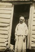 view Lizzie Grant [Gullah informant] digital asset: Lizzie Grant [Gullah informant] in front of her house in Harris Neck, Ga