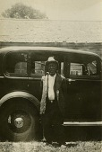 view John (Johnnie) Campbell [Gullah informant] digital asset: Johnnie Campbell [Gullah informant] standing in front of his car in Harris Neck, Ga