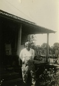 view Gullah man in front of his house digital asset: Gullah man in front of his house