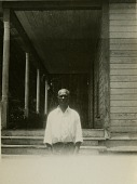 view Gullah man standing in front of his house digital asset: Gullah man standing in front of his house