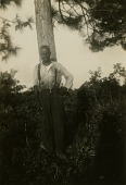 view Gullah man standing in front of tree digital asset: Gullah man standing in front of tree