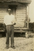 view Parris Capers [Gullah informant] in front of his house in St. Helena Island, S.C digital asset: Parris Capers [Gullah informant] in front of his house in St. Helena Island, S.C