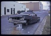 view Abandoned car on cinderblocks digital asset: Abandoned car on cinderblocks