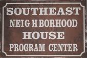 "view Building Sign, ""Southeast Neighborhood House Program Center"" digital asset number 1"